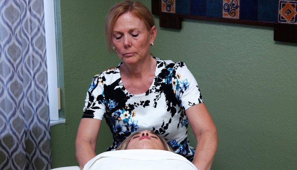 Lorrie with client massage neck 3