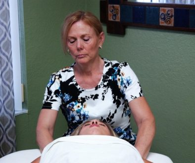 Lorrie with client massage neck 3